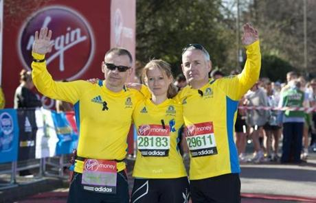Boston Marathon participants Kieth Luxon, Greg Smith, and Tricia Bun paused ahead of the London Marathon.