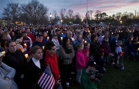 People held candles for Sean Collier at the Town Common in Wilmington.