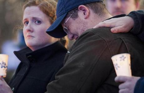 Andrew Collier grieved during the vigil for his brother, the MIT police officer killed Thursday.