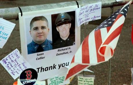 A tribute to slain MIT Police Officer Sean Collier and injured MBTA officer Richard Donohue Jr. was seen Sunday at the memorial.