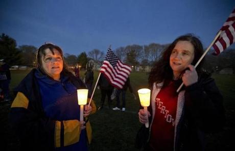 Julie Maloney (left) and her sister, Cynthia Maloney, attended a vigil in Watertown.