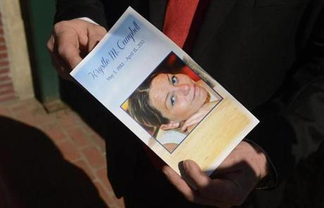 An unidentified mourner showed a program containing pictures of Krystle Campbell at her wake in Medford.