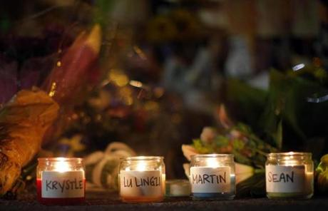 Candles were lit for those who died in the Marathon bombings and the subsequent manhunt at a Boylston Street memorial.