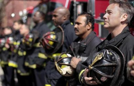 Firefighters who were first responders at the Marathon bombings observed a moment of silence.