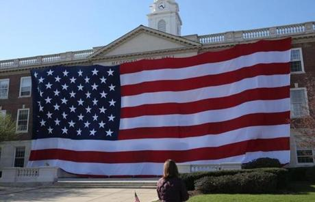 A flag draped Medford City Hall Monday morning in honor of Boston Marathon victim Krystle Campbell, a native of the city.