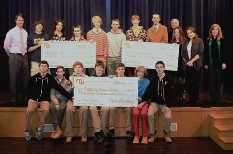 Ninth graders from the Fenn School in Concord recently presented checks totaling $9,000 to representatives from the Buddy Dog Humane Society in Sudbury, Heading Home in Cambridge, and the Discovery Museums in Acton as a culmination of their Youth in Philanthropy program.