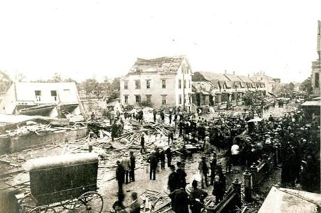 July 26, 1890: The tornado that swept through Lawrence hit at 9:15 a.m. and left behind it a pathway 300 feet wide, strewn for nearly a mile with the wreckage of almost a hundred houses. This is the view looking southwesterly from near the east end of Springfield Street.