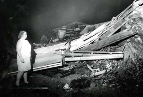 July 21, 1972: Marguerite D'Amelio looks over debris which was her home on Sierra Road in North Chelmsford. The storm that hit Chelmsford had been sighted by radar at 4:58 in Manchester, N.H. It moved east-southeat at 20 mph and struck at 6 p.m. Area residents reported a heavy violent thunderstorm, then a period of calm before the storm's funnel, reportedly hundreds of yards wide, struck.