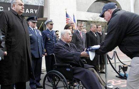 Mayor Menino  received the US flag that was flown over the finish line at the Marathon from an FBI official, who symbolically turned jurisdiction of the bombing site over to the city Monday.