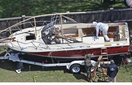 In Watertown, investigators continued to gather evidence from the bullet-ridden boat where suspect Dzhokhar Tsarnaev was found hiding on Friday.