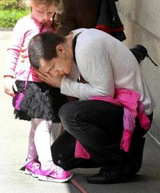 Boston, MA--4/24/2013--Boston Bruins defenseman Andrew Ference (cq) prepares to leave the concert early because his 4-year-old daughter, Stella Ference (cq), was hungry. He saw a tweet about the event. The Boston Public Library offers a 12:30 concert in its McKim Courtyard, on Wednesday April 24, 2013, the day Boylston Street is opened to the public, following the bomb attacks during the Boston Marathon. The Gioviale Quartet (cq), an honors ensemble for New England Conservatory, plays works by Turina (cq), Debussy (cq) and Schubert (cq). Left to right, they are: Jeremias Sergiani-Velazquez (cq) (violin), Li-Mei Liang (cq) (violin), Kenny Lee (cq) (cello) and Tingru Lai (cq) (viola). Photos by Pat Greenhouse/Globe Staff Topic: BPLreopening Reporter: Meredith Goldstein