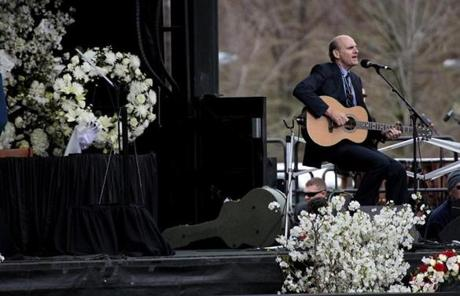 James Taylor warmed up before the memorial service.