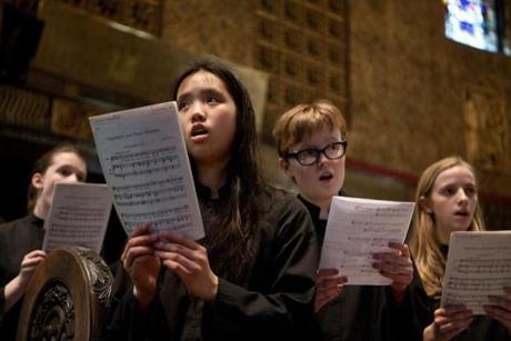 The Trinity Choristers, a choir of boys and girls ages 8 to 18, sang before the evensong service Wednesday.