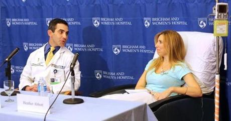 Bombing victim Heather Abbott spoke with her surgeon, Dr. Eric Bluman, at a Brigham and Women's Hospital press conference about her decision to amputate below the knee.