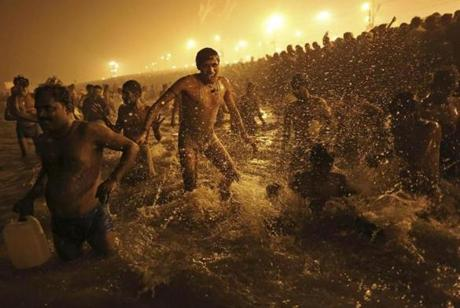 The Hindu faithful at the confluence of the Ganges and Yamuna rivers during the Kumbh Mela in Allahabad, India.