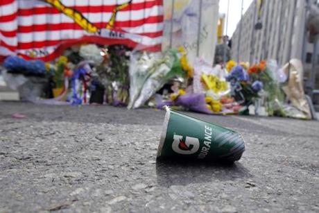 A memorial, and debris, in Back Bay the day after the race.