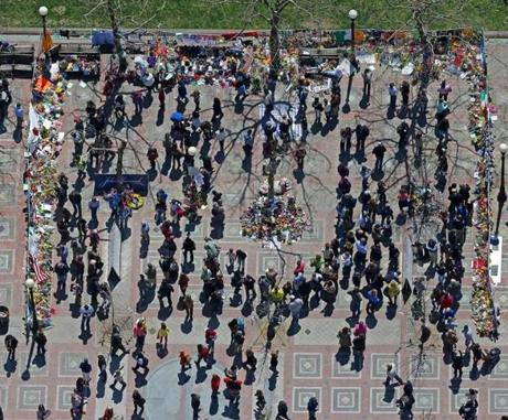 Impromptu memorials to the Boston Marathon bombing victims drew crowds of visitors to Copley Square in downtown Boston at noontime on Friday.