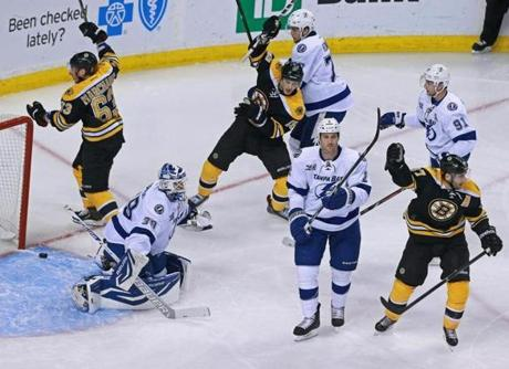 Dennis Seidenberg wasn't in this celebration, but he scored the goal that touched it off.