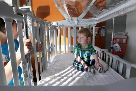 Boston, MA--4/27/2013--In his new crib, Logan Blais (cq), 20 months, of Newport, VT, does not react to the coos of registered nurse Teresa Reddy (cq). Patients are moved from 125 Nashua Street to the new location of Spaulding Rehabilitation Hospital Boston (cq) at 300 First Avenue in the Charlestown Navy Yard, on Saturday, April 27, 2013. Photos by Pat Greenhouse/Globe Staff Topic: 28spaulding Reporter: Dan Adams