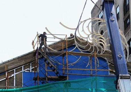 A crane hoisted the sculpture to the pediment of the Cathedral Church of St. Paul, on April 27.