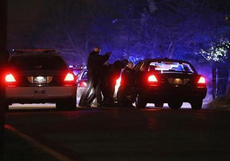A report of a carjacking by the suspects led to a gunfight early Friday in Watertown. Transit Police Officer Richard Donohue Jr. was wounded in the shootout.