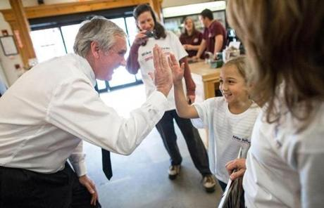 Republican candidate Michael J. Sullivan, a former state and federal prosecutor, highfived 7-year-old Judy Rodolakis at Davidian Brothers Farm in Northborough.