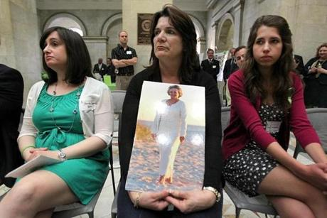 Michele Miller held a photo of her mother, Jeanne Cloutier of Auburn, who died of Lyme disease in February. She sat with Jennifer Crystal (left), a writer and blogger who has Lyme disease, and  Sarah Albanesi of state Senator Bruce Tarr's office as a rally was held at the State House for Lyme disease awareness.