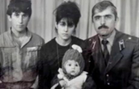 In this image from a video by the suspects' aunt, Anzor Tsarnaev (left) and Zubeidat Tsarnaeva pose with Anzor's brother, Mukhammad, and baby Tamerlan.