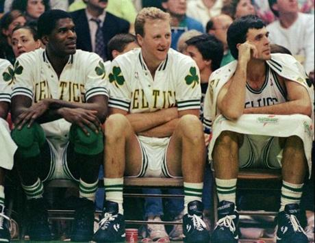 Robert Parish, Larry Bird, and Kevin McHale.