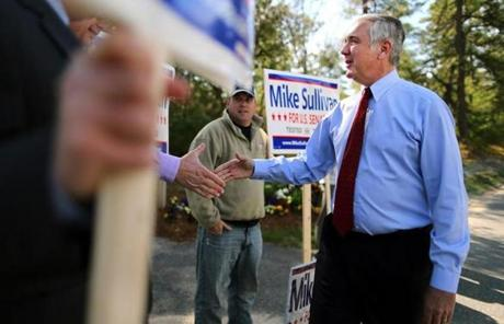 Michael Sullivan greeted campaign volunteers at a Plymouth polling station.