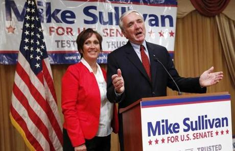 Republican Michael Sullivan, right, accompanied by his wife, Terry, conceded victory to opponent Gabriel Gomez.