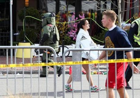 After two blasts near Copley Square, an official in protective clothing was called to a package near Kenmore Square.