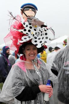 One woman wore a jockey-themed hat.