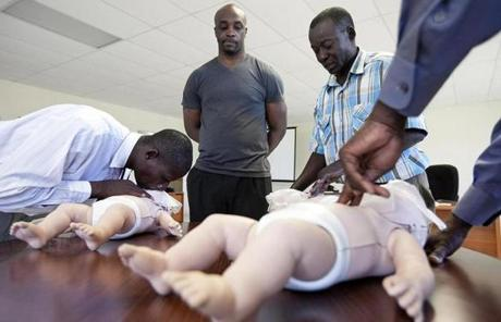 Roy (center) became certified to teach CPR to security workers in Haiti as part of his work through the Thomas S. Durant Fellowship for Refugee Medicine.