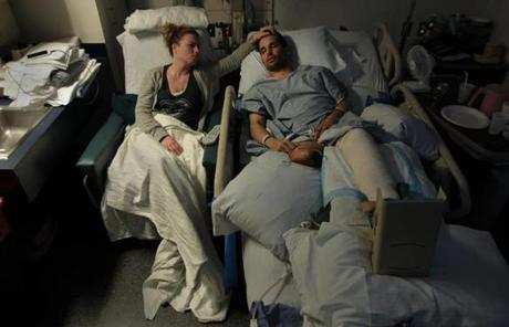 Jen Regan, fiancee of Marathon bomb victim Marc Fucarile, stroked his forehead at Massachusetts  General Hospital.