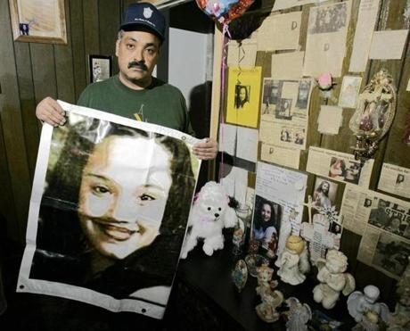 In this 2004 file photo, Felix DeJesus, the father of missing woman Gina DeJesus, was seen with a memorial to his daughter in his Cleveland home.