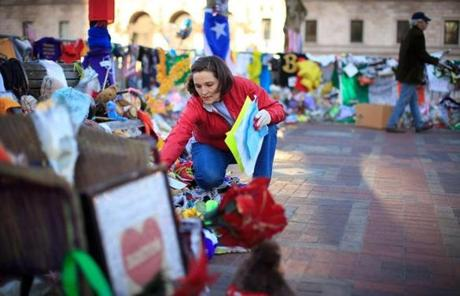 City workers culled through the makeshift memorial in Copley Square to remove fragile items so the keepsakes can be preserved.