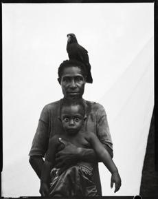 """Urista Korimbun, Baby Bono Korimbun, and Green Parrot, Govermas Village, Middle Sepik."""