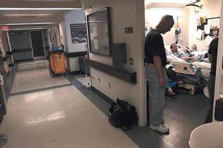 An emotional Edward Fucarile stood in the doorway of  his son Marc's hospital room at MGH.