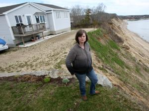 Jessica and Tony Bosari spent $20,000 to move their house on Nameloc Road 30 feet farther back from the shore.