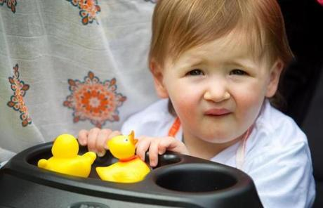 Summer Maki, 1, of South Boston, took her rubber duckies with her to the parade.