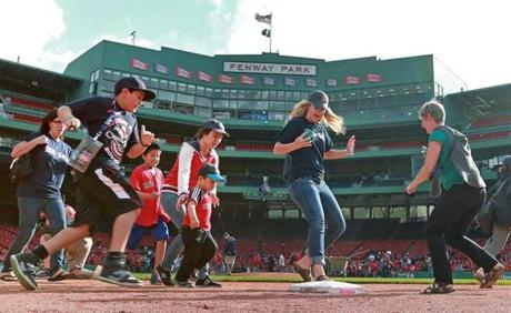 Mothers, children, and spouses were allowed to run the bases following the Mother's Day game against the Toronto Blue Jays at Fenway Park.