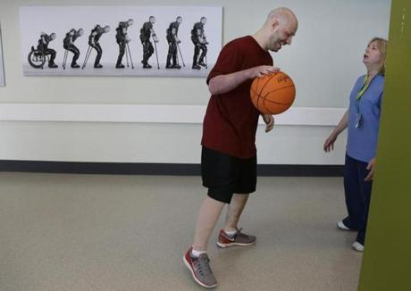James Costello dribble a basketball at Spaulding Rehabilitation Hospital.