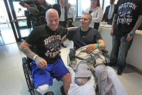 Paul (left) and J.P. Norden, who grew up in Stoneham, engaged in playful competitive banter during a news conference after their release from Spaulding Rehabilitation Hospital in Charlestown. The brothers each lost a leg in the Boston Marathon bombings.
