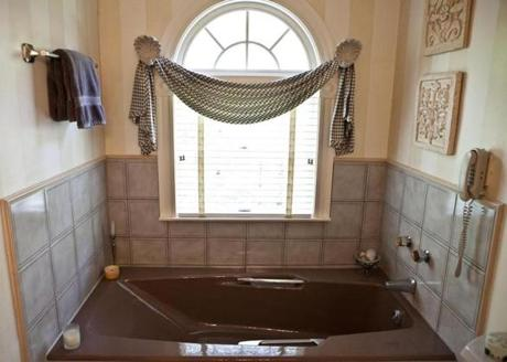The master bathroom has a separate shower and a soaking tub.