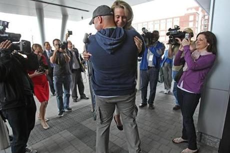 Boston Firefighter Mike Materia hugged Marathon bombing survivor and amputee Roseann Sdoia after her release from Spaulding Rehabilitation Hospital in Charlestown. Materia was credited with helping to save Roseann Sdoia by holding her tourniquet and transporting her in a police prisoner transport van when there were no ambulances.