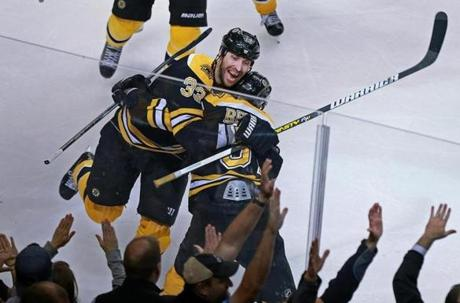 The fans went wild as Zdeno Chara hugged teammate Patrice Bergeron after Bergeron scored the game (and series) winner in overtime.