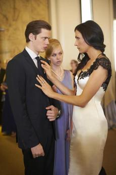 "Bill Skarsgard, Penelope Mitchell (center), and Famke Janssen in ""Hemlock Grove."""