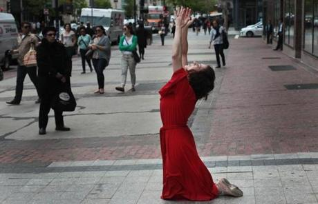 The dancers commemorated the one-month anniversary of the bombing at the scene of the first bomb on Boylston Street.
