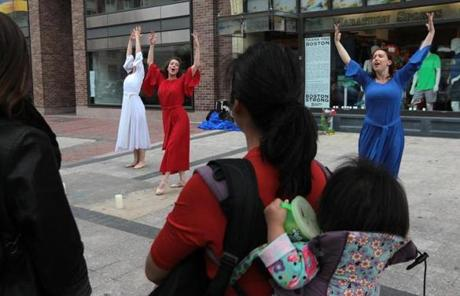 Dancers (from left) Laura Sune, Christine Monterio, and Maggie Jarmolowski on Boylston Street Wednesday.